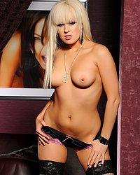 Syren Sexton strips from her black lingerie wearing black stockings